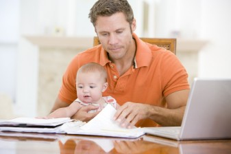 Father-and-baby-in-dining-room-with-laptop-337x224